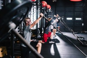 strength training on weights at Raleigh gym