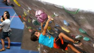 kid on overhung boulder